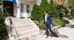 Business man walking to the front steps