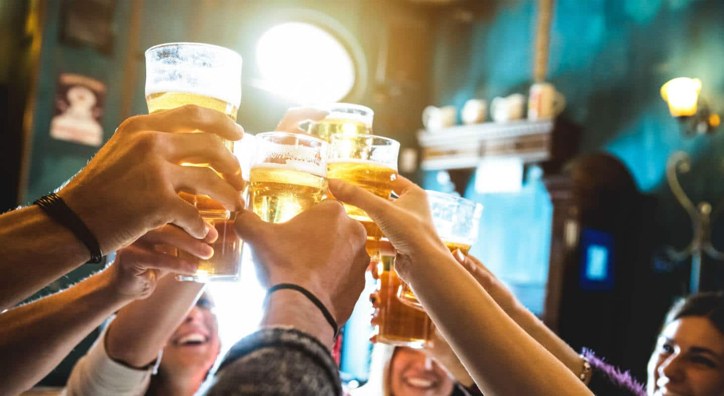 Friends toast local craft beer at brewery pub