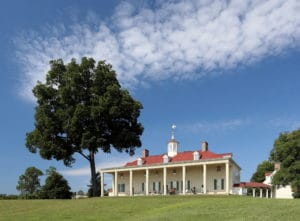 Mt. Vernon exterior photo, large two-story white house with numerous windows and red roof.