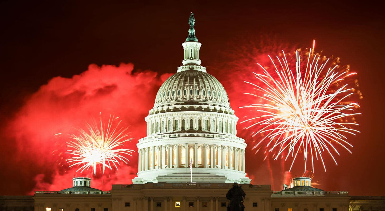 Red fireworks going off over U.S. Capitol Building
