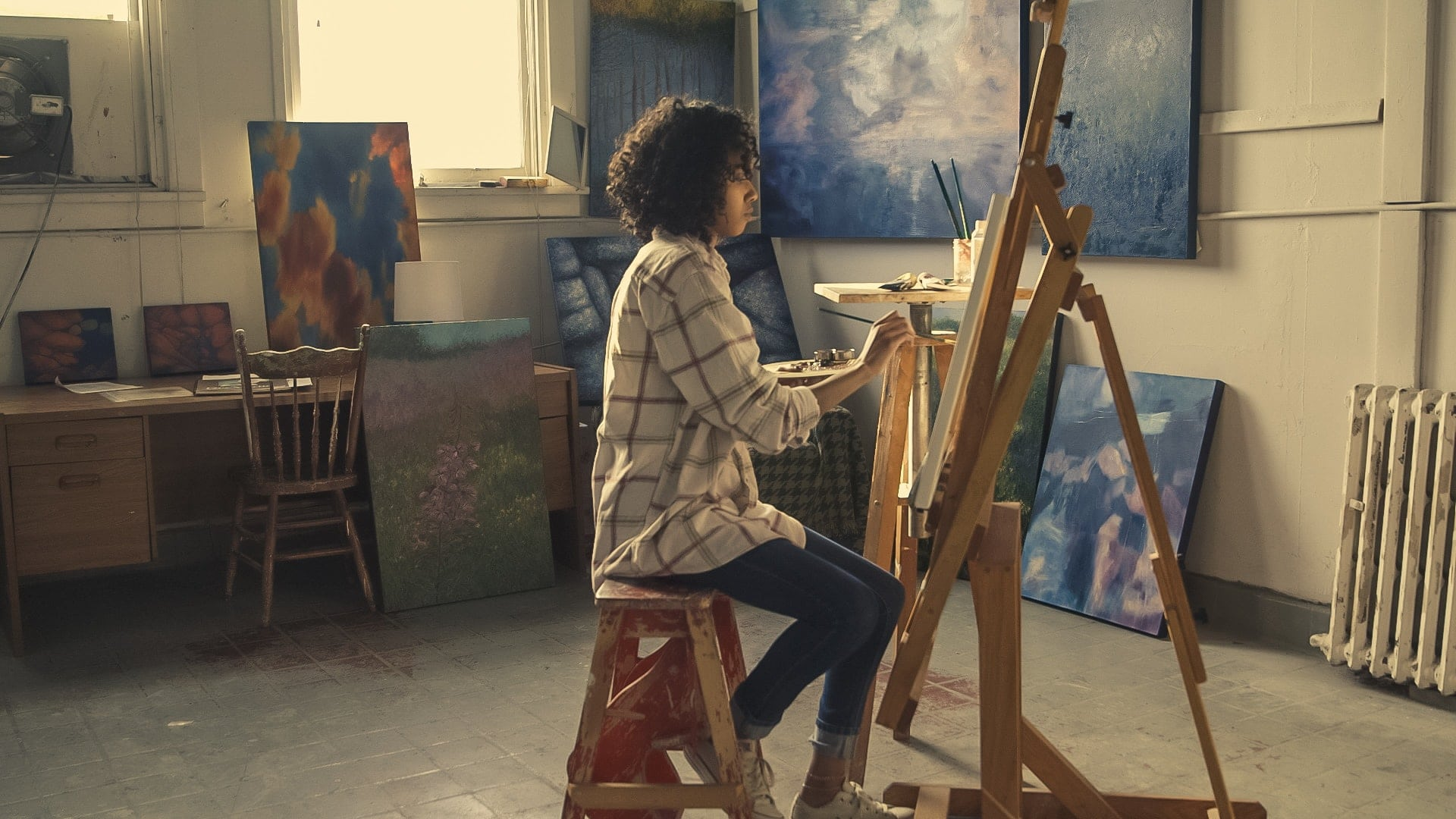 Woman painting at an easel