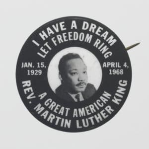 Black and white pin-back pin depicting MLK - Unidentified Maker