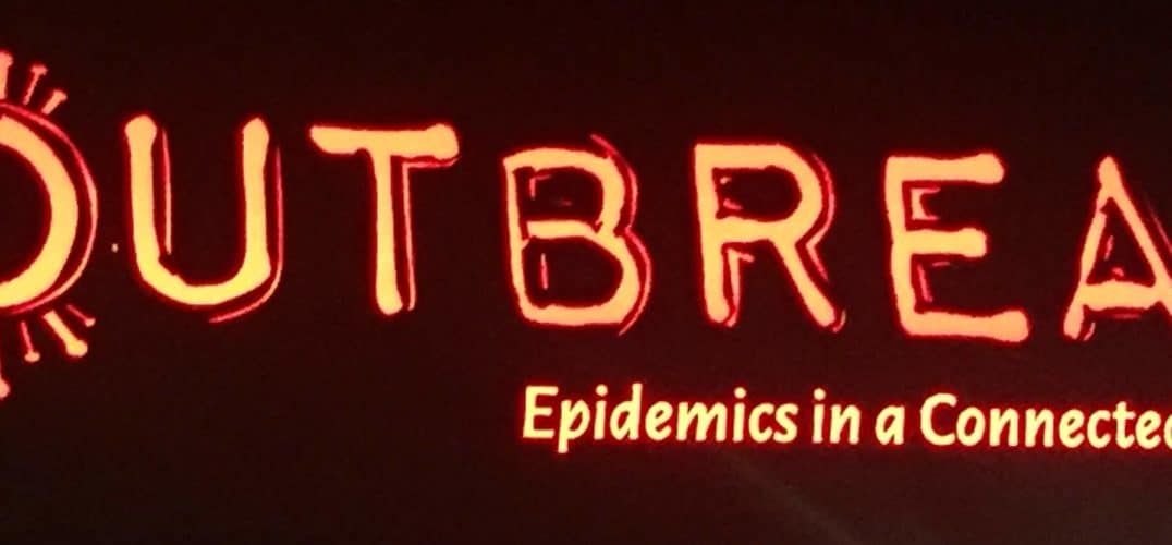 Neon red sign reading: Outbreak