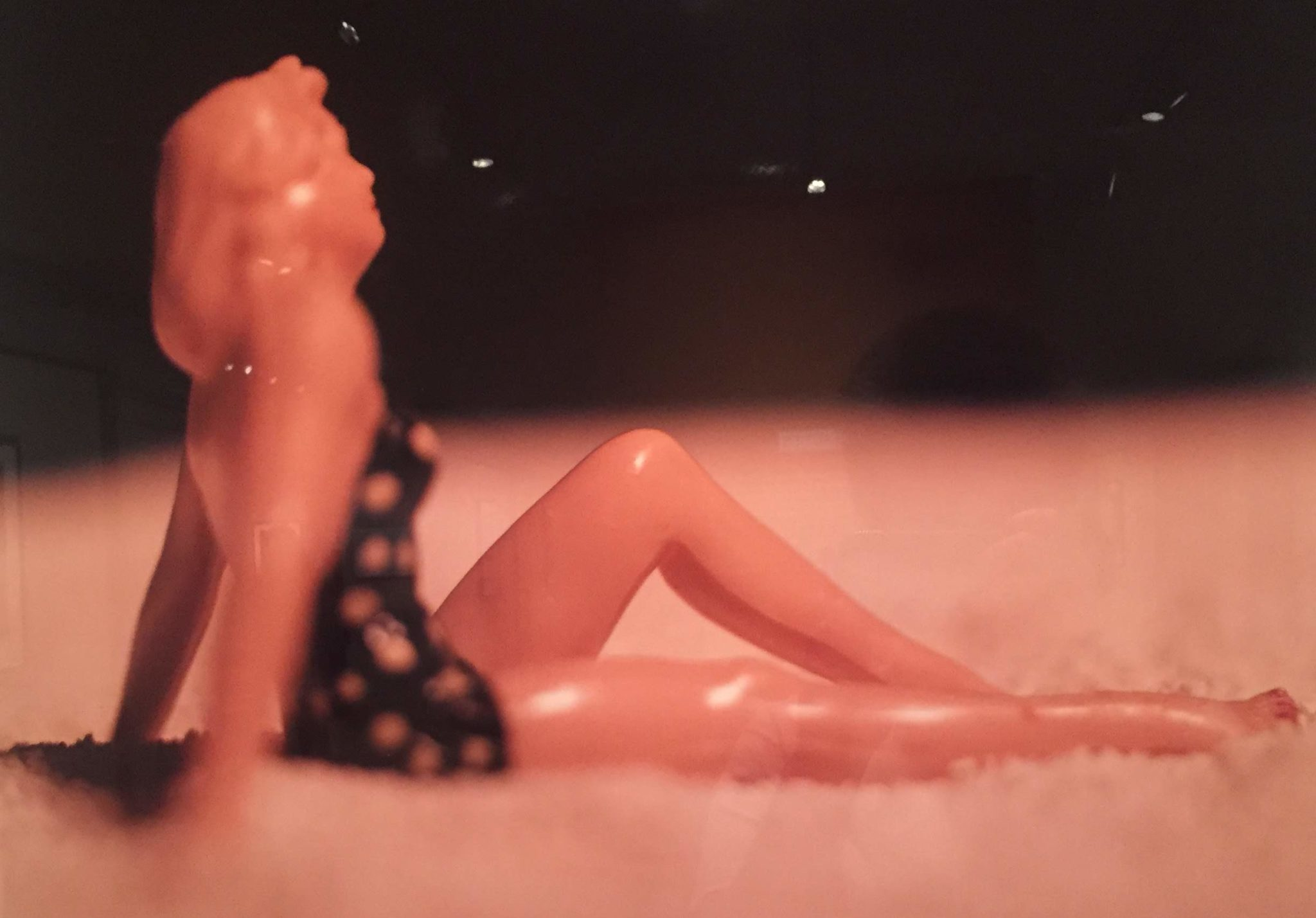 Levinthal photograph of a woman relaxing in a swimsuit