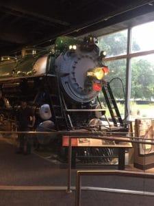 Antique green train engine.