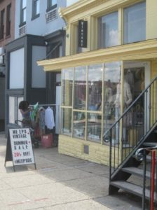 Yellow storefront with a sign outside that says 'Meeps Vintage.'