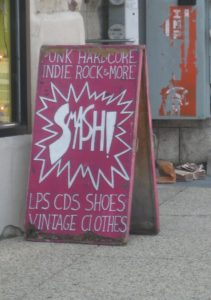 Pink sign reading 'Smash' with information about the store.