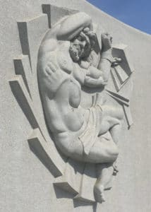 Depiction of a nude man whose arms and legs are shackled.