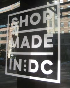 Window art reading 'Shop Made in DC'