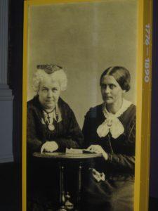 Two women suffrage leaders sitting side by side.