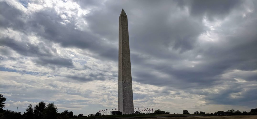 The Washington Monument against a dramatic cloudy sky