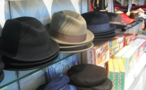 Row of old fashioned men's hats