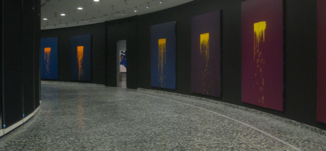 Display of paintings along a curved wall
