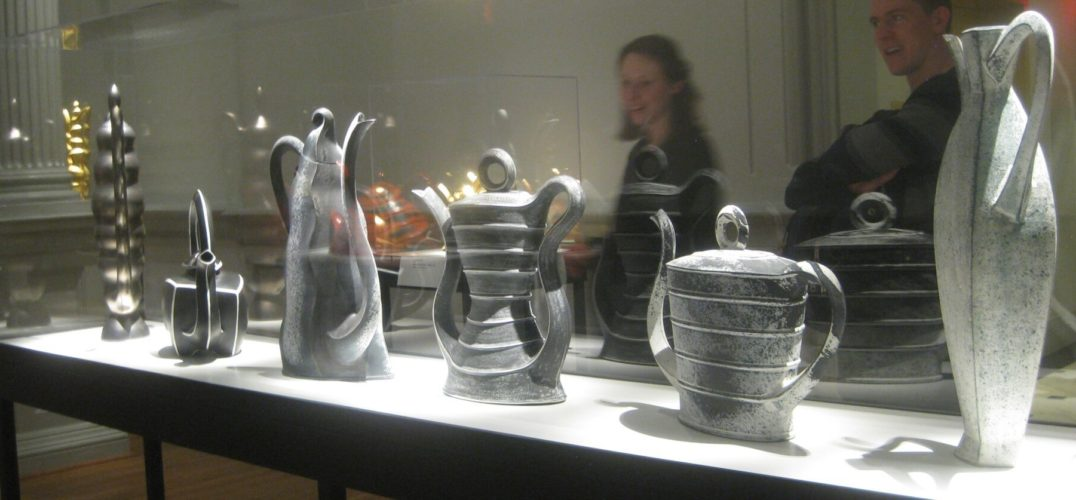 A row of grey teapots.