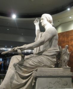 Side view of the George Washington statue focusing on the sword arm.