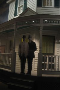 A life sized cut out of the two brothers positioned on the porch.