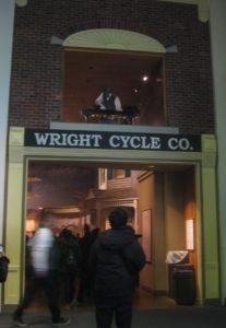 An entryway in a brick facade. A sign over the facade says 'Wright Cycle Co.'