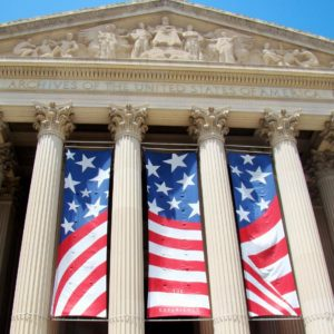The front of the National Archives Museum is decorated with American flag banners