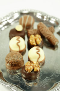 An assortment of chocolates displayed on a silver platter