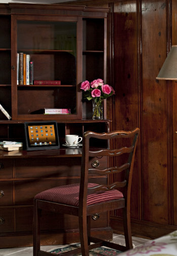 Built-in wirting desk with pink flowers and laptop computer