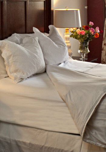 Large cozy bed with white bedding