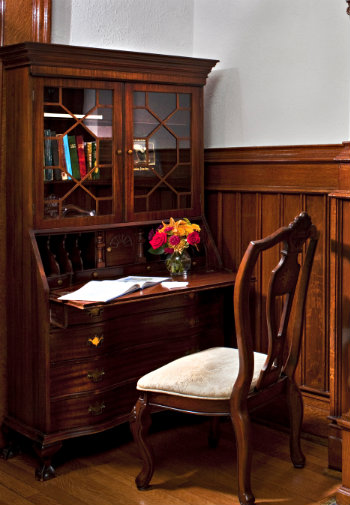 Elegant wooden writing desk with chair
