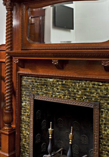 Fireplace with tile surround and wooden mantle