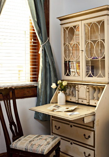 White and gilt writing desk with sunny window