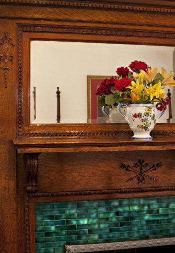 Lovely old fireplace with teal colored tile surround