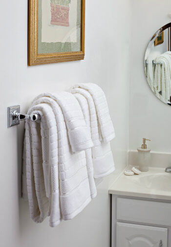 All white bathroom with fluffy white towels